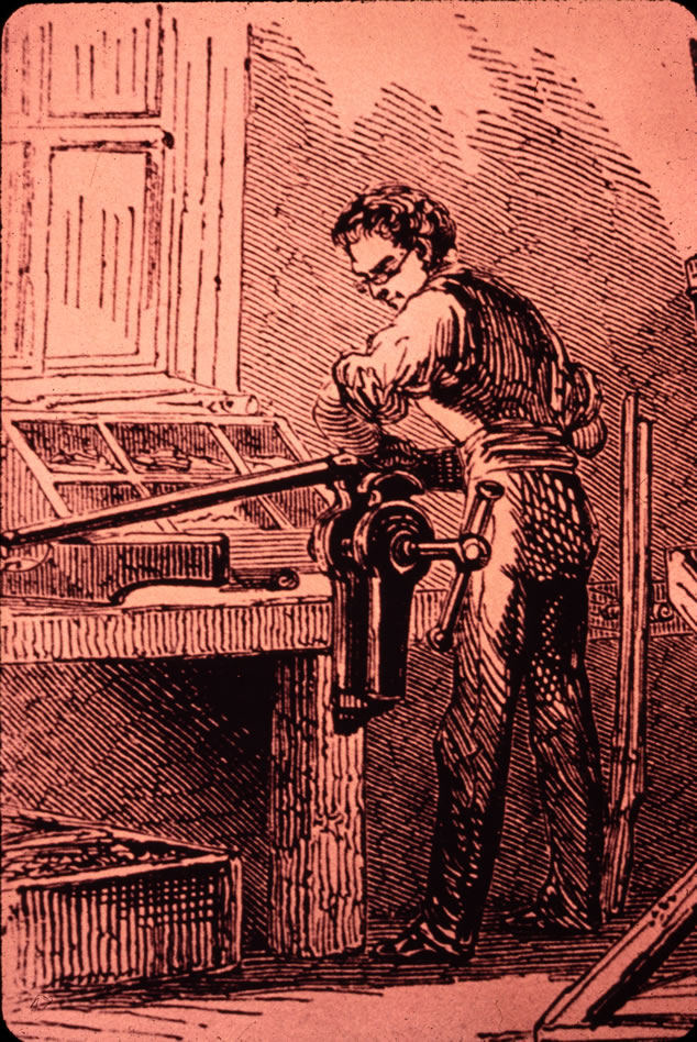 An armory worker straightens a barrel in this illustration.