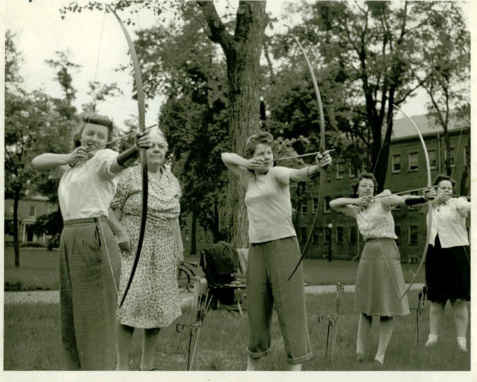 Women workers take a break for some archery lessons